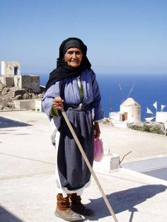 This post takes you to the Karpathiko Spiti (Karpathian House) on the Greek island of Karpathos, where homes are personal museums of the island's folklore, customs, and crafts spanning generations. Zorba The Greek, Old Faces, Greek Culture, Art Poses, Crete, Greek Islands, Persona, People, Karpathos Greece