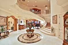 Grand entrance, but wouldn't it make more sense to carry the marble all the way up the staircase? In a home of this caliber, cost couldn't have been the issue...