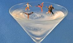 Figure skaters on a frozen martini. Italian artists Antonio Magliocchetti and Stefano Adorinni create everyday scenes in minute detail using food and drink.