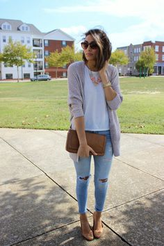 Shop this look on Lookastic:  https://lookastic.com/women/looks/open-cardigan-crew-neck-t-shirt-skinny-jeans-ballerina-shoes-clutch-sunglasses-pearl-necklace/4167  — Brown Leather Clutch  — Light Blue Ripped Skinny Jeans  — Brown Leather Ballerina Shoes  — Grey Open Cardigan  — Pink Pearl Necklace  — White Crew-neck T-shirt  — Dark Brown Sunglasses