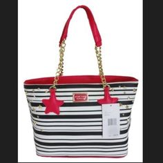 """💝SALE💝Betsey Johnson Star Studded Stripe Tote NWT Black & white striped tote with fushia detailing by Betsey Johnson..fun star accent shapes on handles and gold studded star detailing on each side of bag...measures 12""""x10""""x5 ...8"""" Shoulder drop straps...one interior zip & 2 interior slip pockets...goldtone hardware..I would definitely consider this a medium size tote..a super fun & awesome tote to rock this spring & summer...💕 Betsey Johnson Bags Totes"""