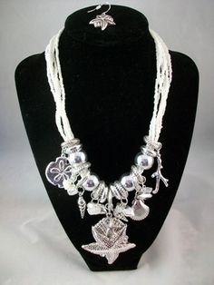 White Seed Bead and Silver Sea Charm Necklace.  Beautiful and comes with matching sea themed earrings.