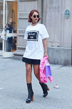 "A proud high school dropout, she made a provocative statement wearing a Hyein Seo T-shirt emblazoned with ""School Kills,"" and platform boots while out and about in New York City."