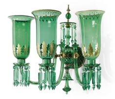 A large pair of Emerald green cut glass three light wall appliques by F & C Osler  1865 The firm of F & C Osler of London and Birmingham were the leading makers of chandeliers and lighting during the 19th century. Founded by Thomas Osler in 1807 in Birmingham the factory specialised in glass furniture and chandeliers for the overseas market - most notably for the Indian Maharajas.