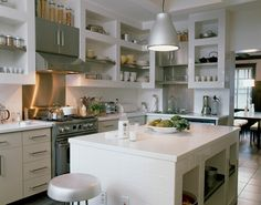 love all this sturdy white open shelving in this kitchen.