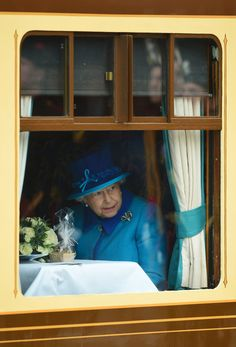 Queen Elizabeth II Photos - Queen Elizabeth II looks on at Waverley Station from the window of the steam locomotive 'Union of South Africa' on September 9, 2015 in Edinburgh, Scotland. Today, Her Majesty Queen Elizabeth II becomes the longest reigning monarch in British history overtaking her great-great grandmother Queen VictoriaÃ•s record by one day. The Queen has reigned for a total of 63 years and 217 days. Accompanied by her husband The Duke of Edinburgh, she has today opened the new…