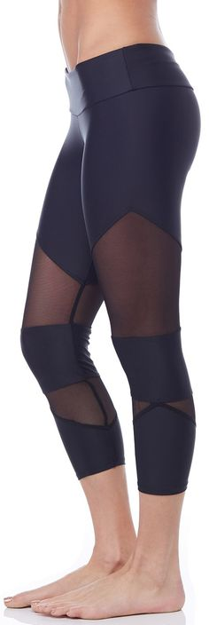 Stay cool and look hot during your next gym session in the Onzie Cut Out Capri. Featuring a sleek Black hue, with mesh cut outs above and below each knee, this capri boasts fashion and performance. #onzie #mesh #evolvefitwear