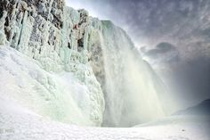 The water thunders on as ice climber Will Gadd nears the top after scaling Niagara Falls on January 27, 2015, covering a 30-foot-wide area of spray ice along the left edge of the Horseshoe Falls on the Canadian side of the falls.