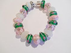 Lampwork and Faceted Glass Beads w Silver/Enamel Bunny Spacer Beads http://www.etsy.com/shop/CharmedByCarol http://stores.shop.ebay.com/charmedbycarol Direct email: carol-soto@att.net