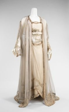1910    The Met saysElegant at-home wear was an essential part of an upper class wardrobe at the end of the 19th and beginning of the 20th century. The tea gown, a structured and boned one-piece dress, was the first manifestation of a trend toward more comfortable attire for wearing in the presence of one's intimates. This ensemble, while elaborate, is significantly less restricting than a tea gown, yet, by the teens, was considered modest enough to be seen in.