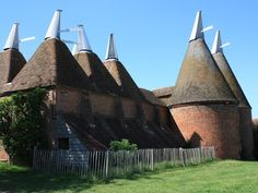 Oast Houses, Kent.  These unusual buildings are kilns where the hops used in brewing are dried.