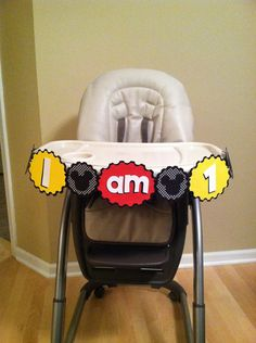 Mickey Mouse high chair banner.