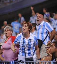 Malaga CF fans react during the La Liga match between Malaga CF and FC Barcelona at La Rosaleda Stadium on August 25, 2013 in Malaga, Spain.