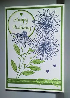 Another birthday card using Stampin' Up!'s Daisy Delight stamp set and coordinating Daisy Punch. The flowers are stamped with their Wisteria Wonder ink, the stems, leaves and sentiments in Garden Green ink - all mounted on Garden Green cardstock. And a couple of coordinating heart elements.