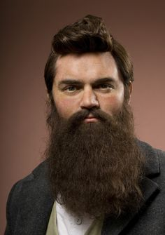 A Ned Kelly beard is a style of facial hair named after Australian bushranger and outlaw Ned Kelly. It consists of a full, luxuriant beard and a moustache, and is typically accompanied by short, styled hair. Hairy Men, Bearded Men, French Pleat, Ned Kelly, Madame Tussauds, Epic Beard, Beard Balm, Beard No Mustache, Hair And Beard Styles