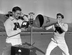 Two University of Minnesota sports team boosters test the volume of a megaphone. Captured by a Minneapolis newspaper photographer on October 7, 1941 ~