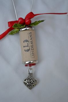 Wine cork ornament with silver heart. God knows i have enough corks to make a few of these ;)
