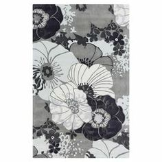 """Add a pop of pattern to your living room or den with this hand-tufted rug, showcasing an oversized floral motif in a light gray and slate hue.  Product: RugConstruction Material: 100% PolyesterColor: Light gray, navy and slateFeatures: Hand-tuftedPile Height: 0.39"""" Note: Please be aware that actual colors may vary from those shown on your screen. Accent rugs may also not show the entire pattern that the corresponding area rugs have.Cleaning and Care: Vacuum regularly with non-beater ..."""