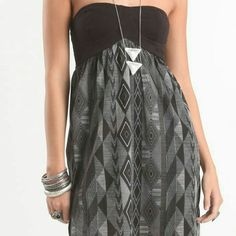 Billabong Seriously Strapless Dress Black tube dress from Pacsun with Aztec print skirt section. Blue Billabong logo on bottom of dress. 55% cotton and 45% modal. Machine wash cold. Worn only a couple of times. Comfy dress to accessorize for a night out or even a great bathing suit cover up! I have detached tags and straps that can send with it. Billabong Dresses Strapless