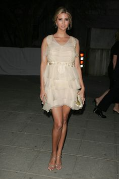 Ivanka Trump Cocktail Dress - Ivanka is a golden beauty in this layered chiffon cocktail dress at the Tribeca Film Festival.