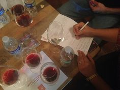 Crew taking detailed wine tasting notes