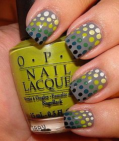 Polka dotted nails in a multiple colored pattern