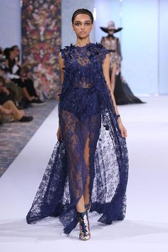 Metallic midnight blue Chantilly lace gown with cape, hand appliquéd with feather butterflies, silk satin, organza and leather blooms.