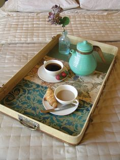 A breakfast-in-bed tray made from an old suitcase lid, lined with wallpaper samples
