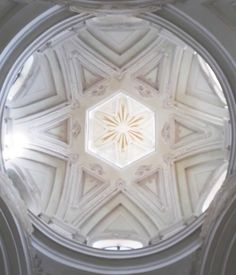 The dome of S.Luigi Church in Corteranzo - Murisengo. Six crossed arches create a six point star and an hexagon in the centre, between the arches six circle windows. Very beautiful the light inside the little church.