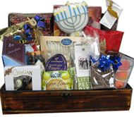 One of our most popular baskets. This wooden wine box is filled with delicious holiday treasures. Chanukah cookies, candles, gelt and dreidel are just a start. We add smoked salmon, Godiva chocolates, flavored coffee, nuts, dried fruit, and more to fill our Chanukah treasure Chest basket. When all the goodies are eaten, the box can be used over and over again.