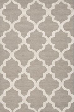 """Over scaled sharp geometrics characterize this striking contemporary range of hand tufted rugs. The high/low construction in wool and art silk creates texture and surface interest and gives a look of matt and shine.  Design:Miami Color:Paper White & Bright White Construction:Hand-Tufted Backing:Yes Pile Height:2/5"""" Style:Modern Content:100% Wool Origin:India"""