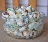 Amish Broccoli Salad:  1    head    broccoli ( chopped ) 1    head    cauliflower ( chopped ) 1    cup    mayonnaise 1    cup    sour cream 1    cup    shredded cheddar cheese 1/2    cup    sugar 1/2    teaspoon    salt 1/2    pound    bacon ( fried, crumbled )