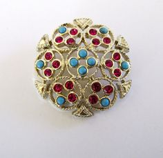 """This signed Sarah Coventry brooch pin is named """"Ceylon"""". It is a gold tone filigree brooch with turquoise cabochons and pink sparkly rhinestones. It has a roll over C clasp and is signed Sarah Cov. Unique Jewelry, Vintage Jewelry, Handmade Jewelry, Alcohol Ink Painting, Homemade Candies, Cool Items, Brooch Pin, Coventry, Vintage Items"""
