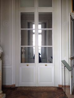 Faux doors in the antechamber, Petit Trianon, Versailles. Marie Antoinette loved her small home that was open to her intimate friends. The king was allowed to visit by invitation only.