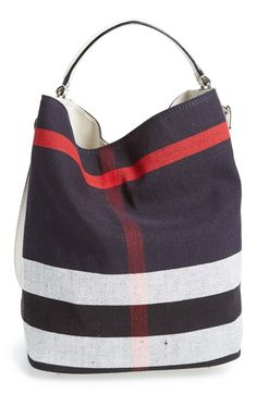 Free shipping and returns on Burberry Brit 'Susanna - Medium' Bucket Bag at Nordstrom.com. Oversized checks lend signature sophistication to a slouchy bucket bag trimmed with smooth, burnished leather. A snap-in zip pouch keeps your essentials organized while doubling as a convenient clutch.