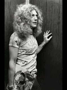 """Robert Plant (looks like he's holding Jimmy Cliff's album, """"The Harder They Come"""" ~ ALW)"""