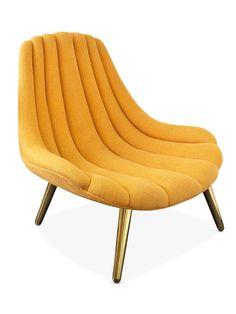 Poltrona Estofada Amarela com pés Dourados. Fonte: Jonathan Adler.