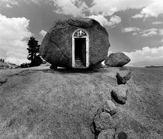 Jerry N. Uelsmann (born June 11, 1934) is an American photographer, and was the forerunner of photomontage in the 20th century in America. Uelsmann is a master printer, producing composite photographs with multiple negatives and extensive darkroom work. He does not carry multiple attachments, but only one camera. His interpretations of landscape elements, reworked, tweaked, and re-contextualized, force the viewer to actively interact with his subjects.