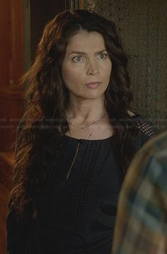Joanna's black keyhole blouse with eyelet sleeve detail on Witches of East End.  Outfit Details: http://wornontv.net/23634/ #WitchesofEastEnd