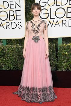 Presenter at the 74th annual Golden Globes awards, Felicity Jones wore a Gucci silk tulle gown with trompe l'oeil beading and crystal bow, and platforms with cat head detail by Alessandro Michele.