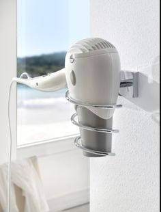 Bath Accessories- no drilling required!  Wall mount hair dryer holder attaches without drilling using a patented mounting hardware system by nie wieder bohren Germany. Designed for tile, stone, glass, metal, mirror, wood and most plastics. Ideal for mounting inside cabinets, direct to mirror or wall mount on tile. Removable as needed with no damage to the surface. Part #HU440-CHR shown in picture