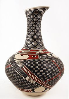 Hector Gallegos urn with a Quetzalcoatl serpent and Native American feather symbol