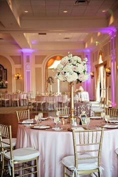 Tall White Hydrangea and Blush Pink Rose Centerpiece Flowers in Gold Vase with Pink Specialty Linens and Gold Chiavari Chairs | Wedding Reception Decor #ChairWedding