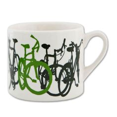 White ceramic mug with a striking black and green bike silhouette illustration. Details Holds 15 oz. Machine wash and microwave safe Dimensions: 3.5 x 6 inches
