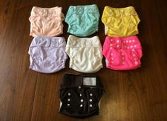 FOR SALE: 7 diapers. Great condition, large and small insert with each.