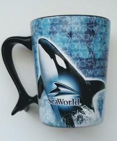 "Official SeaWorld Coffee Mug  Condition Pre-owned  Size: 4.9"" tall  Color: Blue/Black   Style: 3D Graphic 