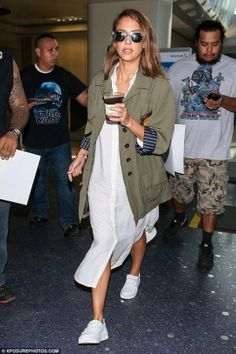 Jessica Alba wearing Smythe Oversized Army Jacket, Sandro Velcro Trainers and Moschino Tweety Bird Iphone Case
