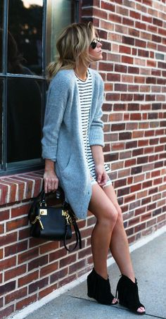 A grey knit cardigan and light blue ripped denim shorts are perfect for both running errands and a night out. Dress down this getup with black cutout suede wedge ankle boots.  Shop this look for $219:  http://lookastic.com/women/looks/cardigan-crew-neck-t-shirt-shorts-crossbody-bag-wedge-ankle-boots/4331  — Grey Knit Cardigan  — White and Black Horizontal Striped Crew-neck T-shirt  — Light Blue Ripped Denim Shorts  — Black Leather Crossbody Bag  — Black Cutout Suede Wedge Ankle Boots