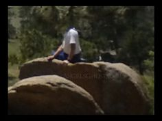 """Taken by Christine: """"I took the pictures at Rocky Mountain National Park in Colorado July 2014. I did not take a picture of this man -- it was just of the scenery; and he is in two of my photos. One (picture) is of his back turned to me and, in the other (photograph), he is turned, looking at me. He appeared in two photos with other photos in between the two he is in. I honest to God believe it to be a ghost -- possibly my father who died 12 years ago in a train/work accident."""