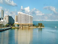 """""""Far from the madding crowd,"""" this Brickell Key hotel with a curved facade overlooking Biscayne Bay is """"a spectacular alternative to Miami Beach."""" Interiors combine """"sophisticated Florida decor with Asian influences."""" All guest rooms have balconies with bay or skyline views—""""we saw a manatee in the water below from our balcony""""—and beds with Anichini linens that afford """"amazing slumber each night."""" At the waterfront Azul, dine on modern European cuisine with American and Asian accents"""